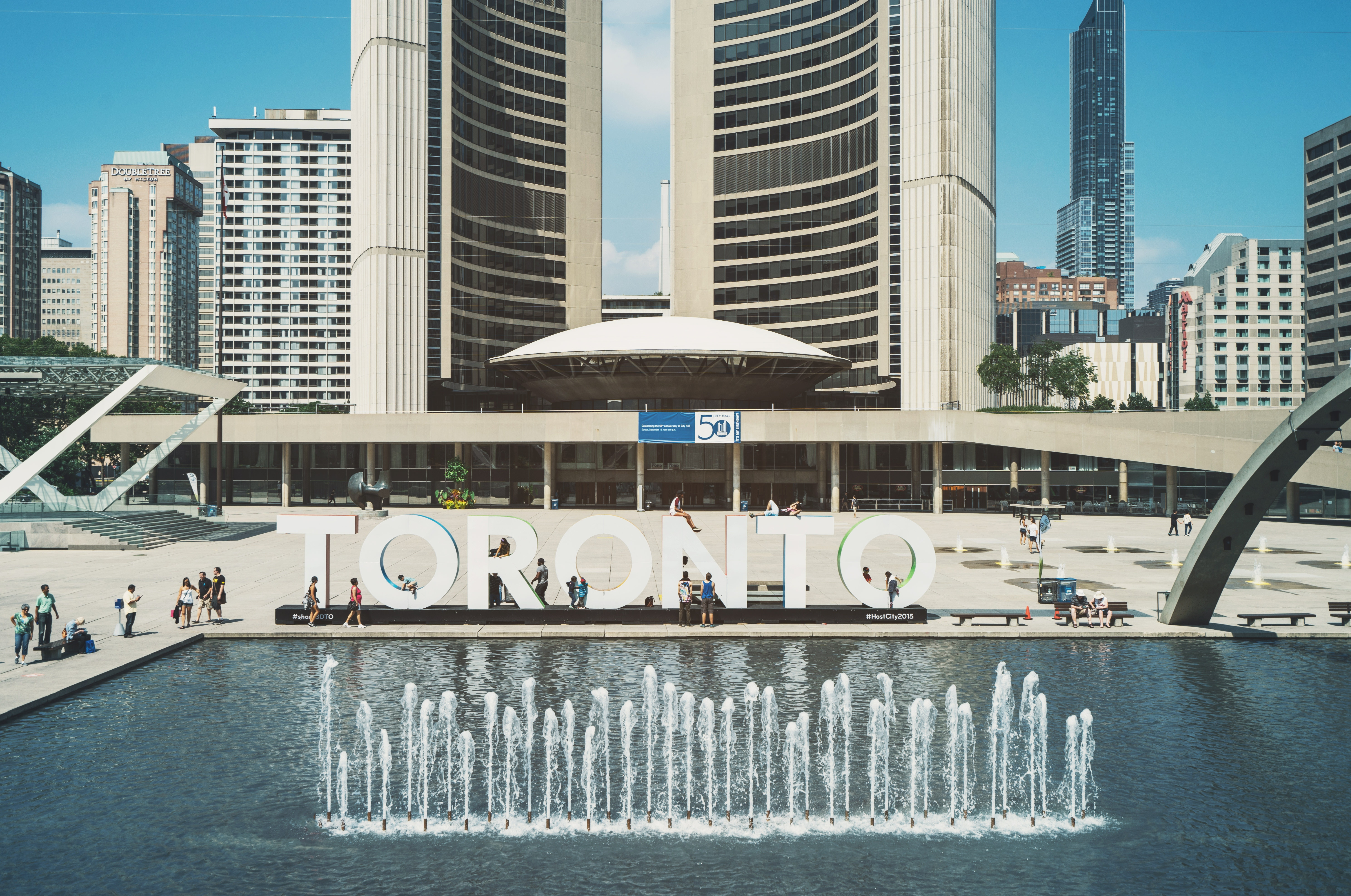 The Toronto sign behind a beautiful fountain piece